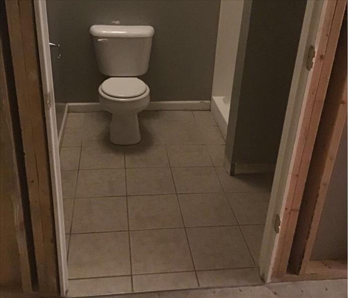 Bathroom with white tile, white toilet and gray walls