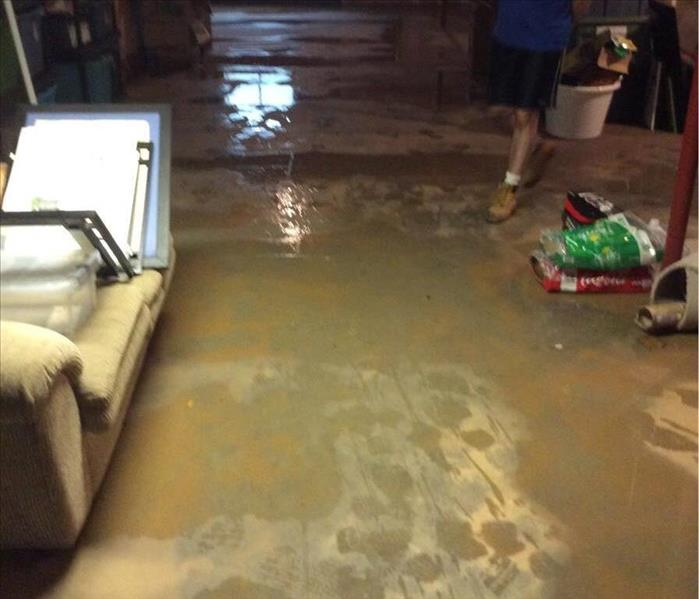 Muddy water puddles in unfinished basement
