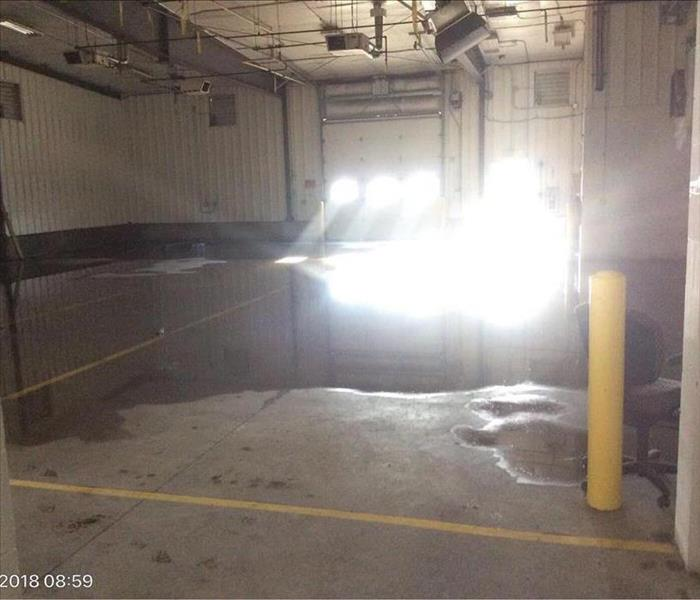 Water on the floor in a commercial garage space